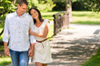 Couple walking in park hand in hand