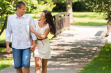 Cheerful Caucasian couple walking outdoors