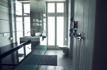 Modern bathroom in gray tones with mosaic on wide angle view