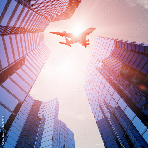 Airplane above city