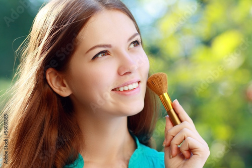 girl with makeup brush