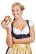 Woman holding pretzel in dirndl