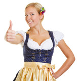 Woman in a dirndl holding thumbs up