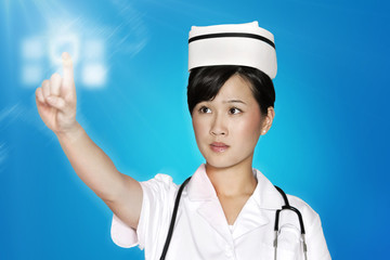 Female nurse using futuristic touch screen over blue background