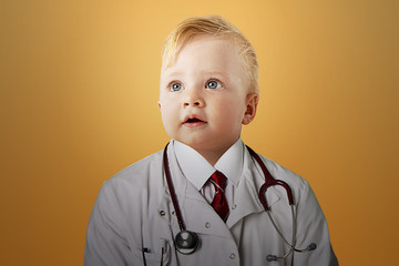 Close up view of Caucasian baby dressed as a doctor