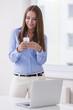 Beautiful businesswoman using cell phone