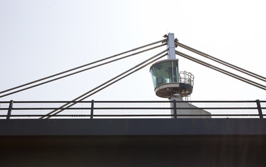 Close-up view of a control tower on top of a bridge