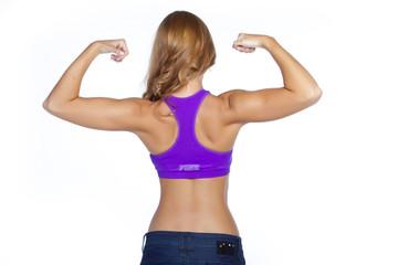trenerka fitness pokazuje swoje plecy