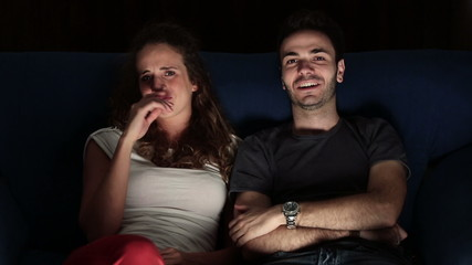 Young Couple Watching Horror Movie