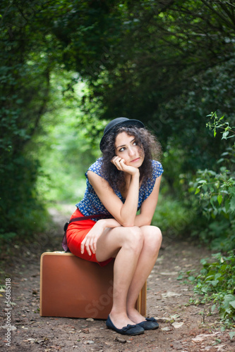 Young woman thinking about her next destination
