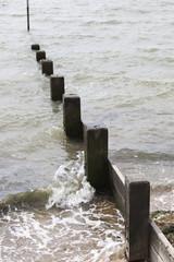 Wave hitting beach Groyne