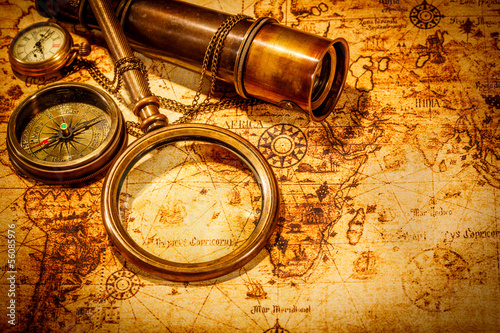 Fototapety, obrazy : Vintage magnifying glass lies on an ancient world map