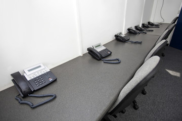 Landline telephones and chairs in television station