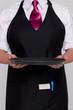 Waitress holding an empty tray