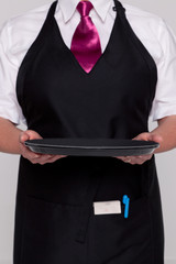 Waitress holding an empty tray