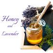 Jar of honey with lavender flowers on a slate chalkboard