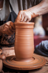 Potter working a piece of clay