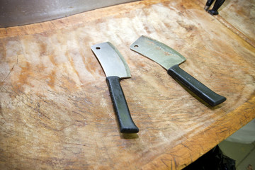 Butcher knife on cutting board in store