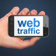 SEO web development concept: Web Traffic on smartphone