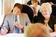 Businessman Eating Sandwich On Train Journey
