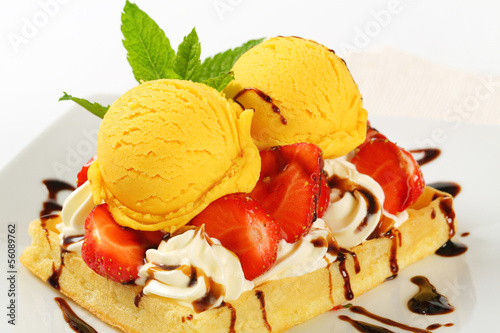 Waffle with ice cream and strawberries
