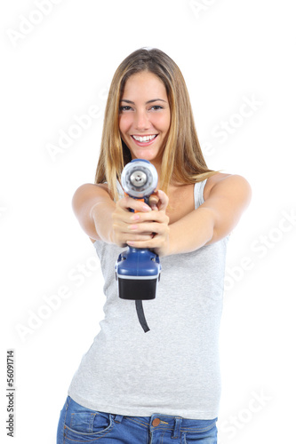 Beautiful woman pointing to a camera with a power drill