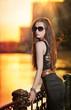 High fashion urban portrait of young, slim, beautiful model