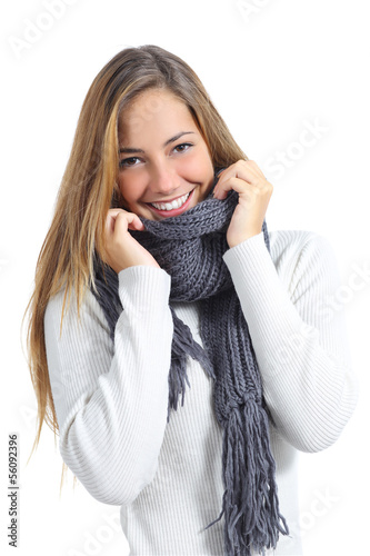 Happy beautiful woman keeping warm in a sweater in a cold winter