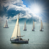 The Sailboats on a sea against a dramatic sky.