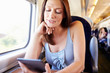 Woman Reading E Book On Train