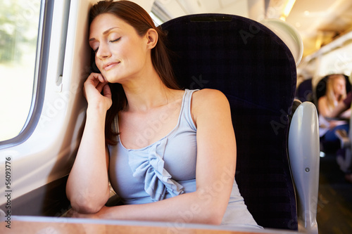 Woman Resting On Train Journey