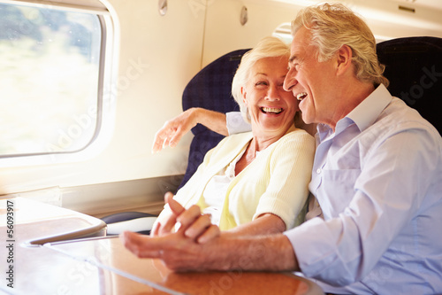 Senior Couple Relaxing On Train Journey