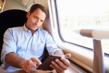 Man Reading E Book On Train
