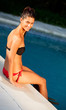 Attractive girl with sitting with bikini