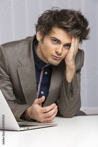 Disappointed stressed overworked businessman