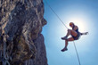 Abseiling woman