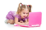 funny child playing with laptop toy