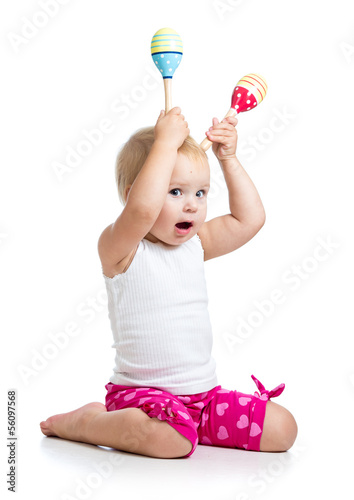 Kid girl playing with musical toys. Isolated on white background