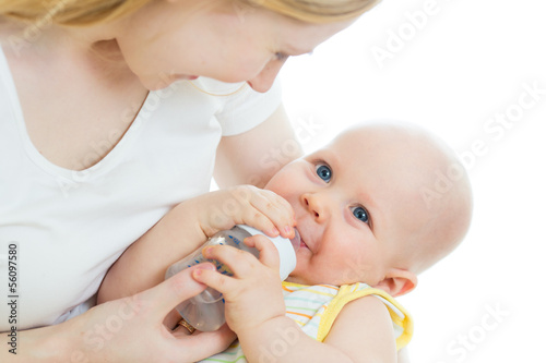 mother feeding baby from bottle