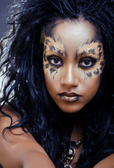 beauty afro woman with leopard make up