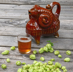 "A  drink of hops and  traditional Ukrainian vessel ""Kumanez"""