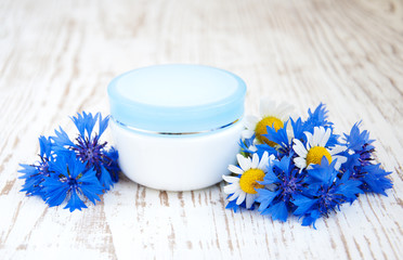 container with cream  and cornflowers