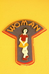Toilet women sign on  wall