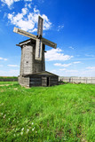 Traditional wooden windmill in russian village