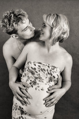 Loving happy couple, pregnant woman with her husband