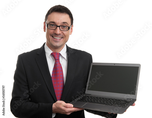 Smiling businessman with laptop computer