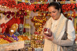 Woman at Christmas decoration shop with balls