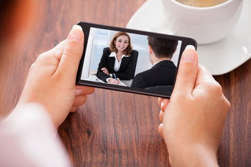 Woman Video Conferencing On Mobile Phone
