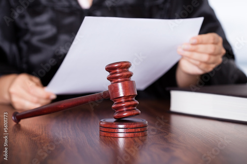 Female Judge Reading Verdict