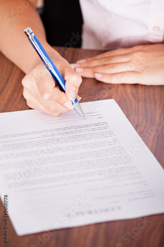 Woman Signing The Contract Paper